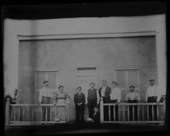 Group of people in front of building.